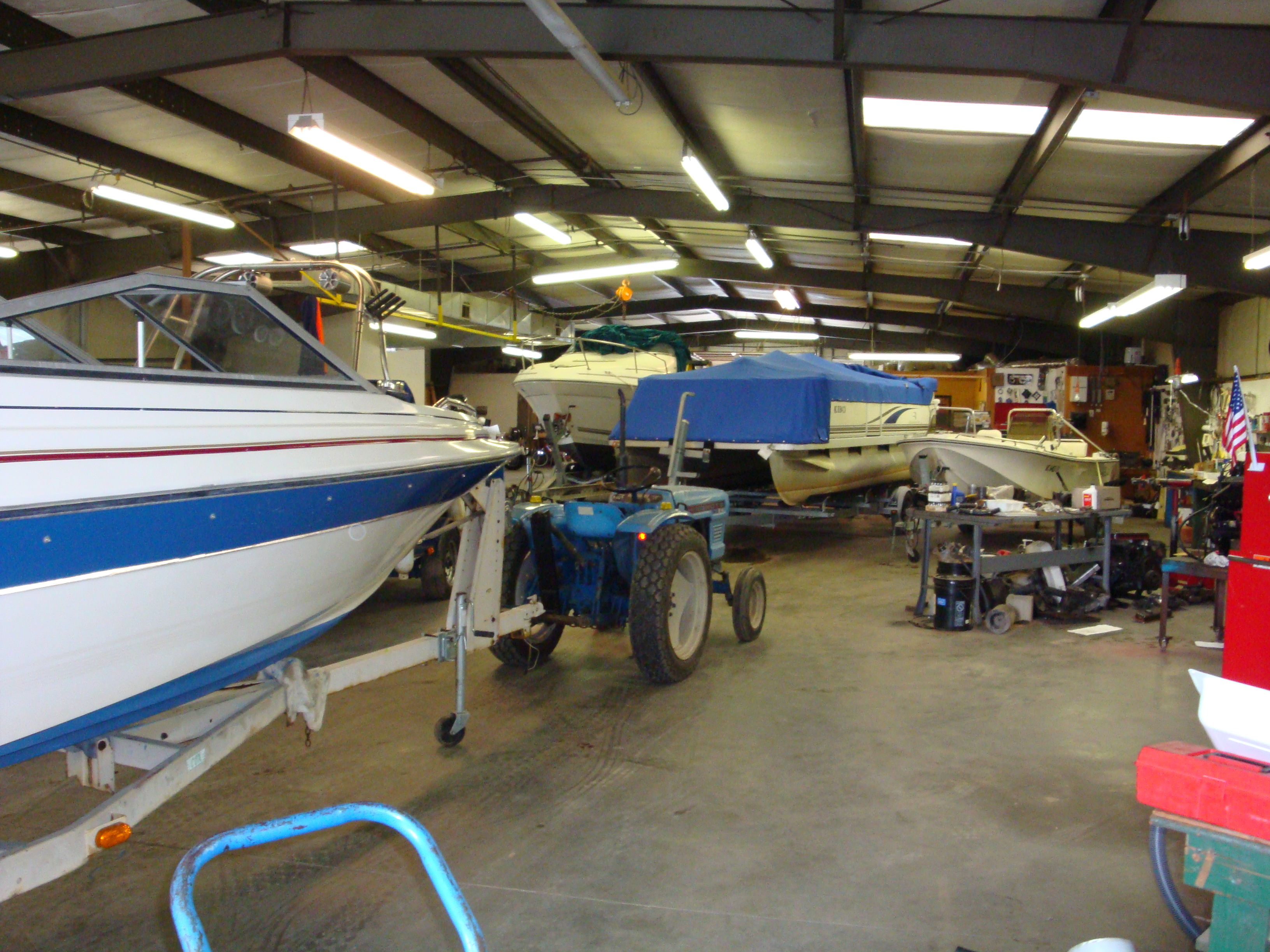 Armstrong marine service see inside our shop we have a for Outboard motor repair shop